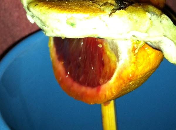 Push a slice of fresh fruit (blood orange) onto stick.  Add a Fruit pancake (we...