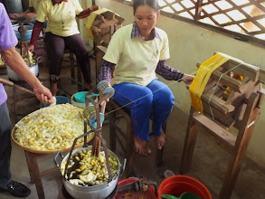 Photo: Boiling the cocoon until transparent and removing the raw silk before the transfer to the fine silk boiling pot