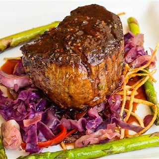 Tim Love's Easy Grilled Steak Stuffed with Roasted Garlic.
