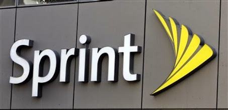 Photo: ** FILE ** A Feb. 28, 2008 file photo shows the Sprint sign over a Sprint store in Los Angeles Thursday, Feb. 28, 2008.   Deutsche Telekom AG is reportedly mulling a bid to acquire Sprint Nextel Corp., The Wall Street Journal Reported Monday, May 5, 2008 citing people it said were familiar with the decision. Bonn-based Deutsche Telekom did not immediately comment on the report, but were it to make such a deal, it would catapult its T-Mobile wireless unit to the top spot in the U.S. market, a lucrative move. (AP Photo/Reed Saxon, File)