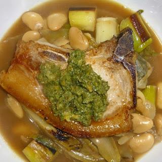 Pork Chops on a Butter Bean, Leek and Endive Stew with Salsa Verde.