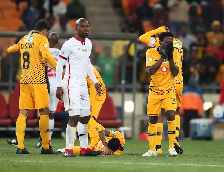 Kaizer Chiefs midfielder Siphelele Ntshangase react in anguish after witnessing a horrific injury to his teammate Joseph Molangoane (lying on floor) during the MTN8 3-0 quarterfinal win over Free State Stars at FNB Stadium on August 11 2018.