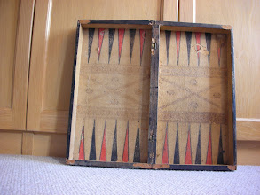 Photo: CH13a  - interior showing backgammon board on printed paper lining