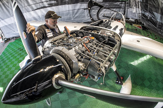 Photo: Chief Technician of Michael Goulian Dennis Sawyer works on the engine of the plane during the training session for the first stage of the Red Bull Air Race World Championship in Abu Dhabi, United Arab Emirates on February 27, 2014. // Predrag Vuckovic/Red Bull Content Pool // P-20140227-00231 // Usage for editorial use only // Please go to www.redbullcontentpool.com for further information. //