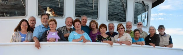 "Photo: The ""Michigan Group"", aboard the National Geographic Sea Lion, Gulf of California, April 2014. l to r: Kathy, Andy, Jeff, Shifrah, Mike, Suzan, Gary, Carol, Liz, Scott, Donna, Rory, Barbara, Gavin, Linda, and Paul"
