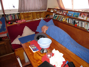 Photo: Not taking any chances the first night, so Andrew sleeps on the main cabin sittee, a bowl within easy reach! (It was not needed!)