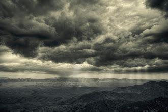 Photo: Sun rays breaking through monsoon clouds over Mount Graham, Arizona