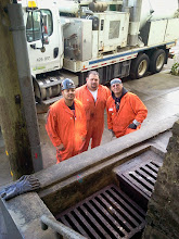 Photo: Robert, Dave, and Efren from the San Francisco Public Utilities Commission after clearing two of four clogged drains at the foot of the Hidden Garden Steps (16th Avenue, between Kirkham and Lawton streets in San Francisco's Inner Sunset District) on February 18, 2014. Work is continuing on other parts of the drainage system--one of the last structural challenges requiring attention on the Hidden Garden Steps site.   For more information about the Steps, please visit our website (http://hiddengardensteps.org), view links about the project from our Scoopit! site (http://www.scoop.it/t/hidden-garden-steps), or follow our social media presence on Twitter (https://twitter.com/GardenSteps), Facebook (https://www.facebook.com/pages/Hidden-Garden-Steps/288064457924739) and many others.