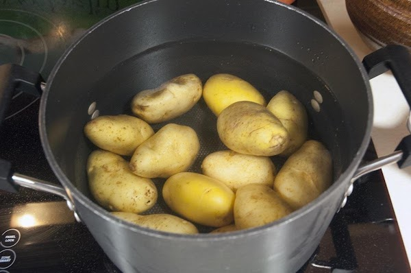 Place the Yukon potatoes into a large pot, and cover with water.