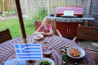 Photo: Once Lara came home from her friends house we had dinner together.  We learned about the Greek flag and learned to speak a few words in Greek.  Lara and I looked at some photos in a beautiful book I bought in Athens and we talked a little about the islands of Greece.