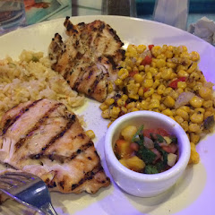 Grilled chicken with mango salsa, roasted corn and rice