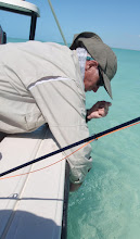 Photo: Fraser Keith releasing a bonefish- Andros Island 2011