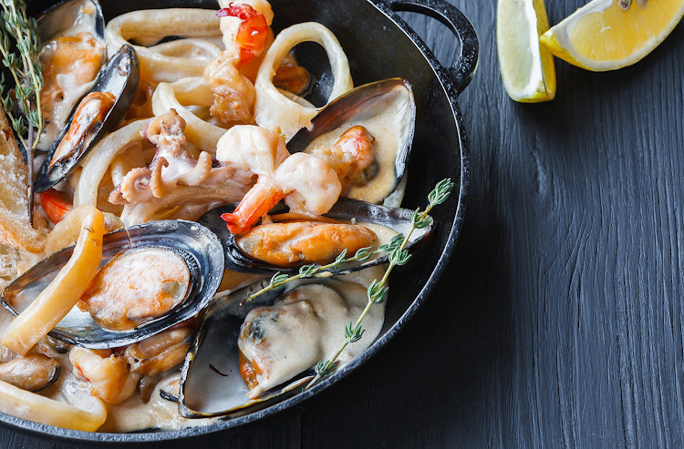 Seafood stew: oysters, shrimps, calamari, all of which come from the ocean and are classified as animals.