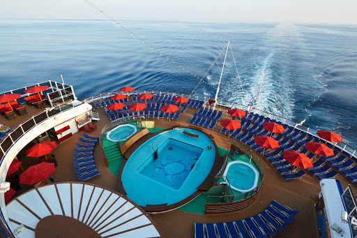 carnival-panorama-Aft-Pool.jpg - Grab a spot at the aft pool aboard Carnival Panorama, sailing from Los Angeles to the Mexican Riviera.
