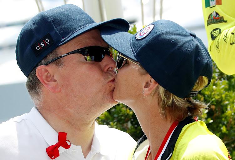 Prince Albert II of Monaco kisses his wife Princess Charlene after she, with her team, won the Riviera Water Bike Challenge in support of the Princess Charlene Foundation in Monaco.