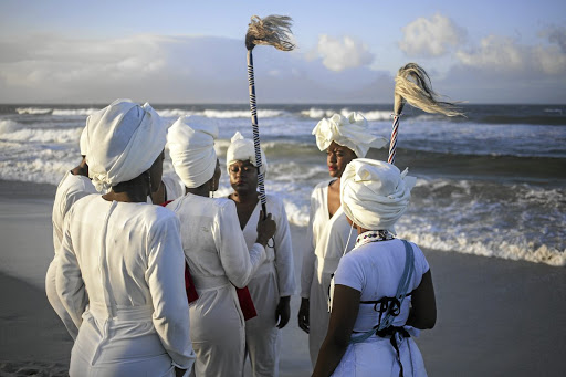 In iYahluma she is accompanied by six women, acting as acolytes, sisters in white. Picture: SUPPLIED