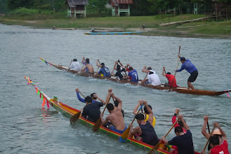 Photo: Two men teams in their boat practice