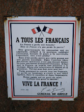 "Photo: At the port is this reproduction (which we have seen elsewhere) of this famous declaration by General De Gaulle in June, 1940: ""To All French people. France has lost a battle! But France has not lost the war! The government has surrendered, giving in to panic, forgetting honor, and delivering the country into servitude. Nevertheless, nothing has been lost! Nothing has been lost, because this war is a worldwide one. In free places, immense forces have not yet acted. One day, these forces will erase the enemy. On that day, France will be given its victory. Then, she will find again her freedom and her grandeur. Such is my purpose, my only purpose! This is why I invite all French, wherever they find themselves, to unite with me in action, sacrifice, and hope. Our homeland is in danger of death. All struggle to save it! Long live France!"""