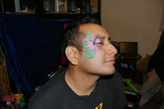 Photo: Flower face painting by Bella the Clown, Bloomington, Ca Call to book Bella today at 888-750-7024