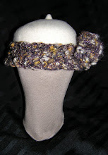 Photo: <KAPELUXE> Unique-Chique Hats by Luba Bilash ART & ADORNMENT  Eggshell wool felt base, hand-crocheted multicoloured yarn band & flower, 360 degree possibilities. Can also be worn on an angle. Size L - 56 cm/22 in $35