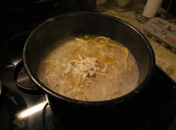 drop all of your noodles in the pan. Using a wooden spoon separate them...