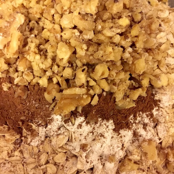 Mix in the flour, oatmeal, cinnamon baking powder, salt and 1/2 cup nuts. Mix...