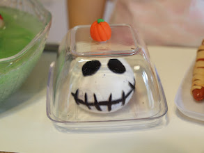 "Photo: Jack Skellington Cheese Ball. The cheese ball is made from Model Magic clay.  The cheese plate and dome is a plastic ""taster"" plate and bowl with a polymer clay pumpkin knob."