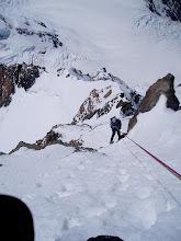 Photo: Time to head down. Bill abseils into the summit rocks.