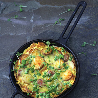 Recipe for Golden Frittata with potatoes, peas, and parmesan.