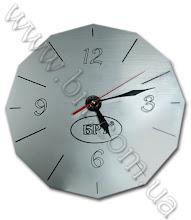 Photo: Часы с логотипом. Серебристо-черный пластик, гравировка лазером, фигурная резка
