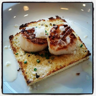 Seared Scallops with Truffle Salt and Champagne Cream Sauce over Truffle Butter Brioche