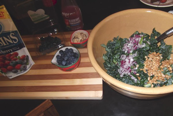 Add sunflower seeds, almonds, cranberries and blueberries.  Toss to mix well.