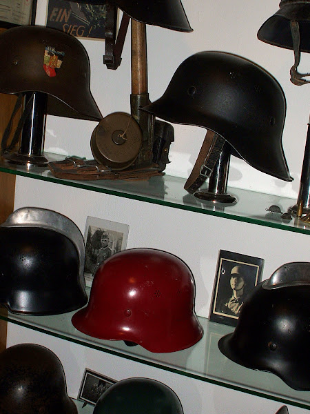 Photo: Some Luftschutz and civil defense helmets. Germany WW2