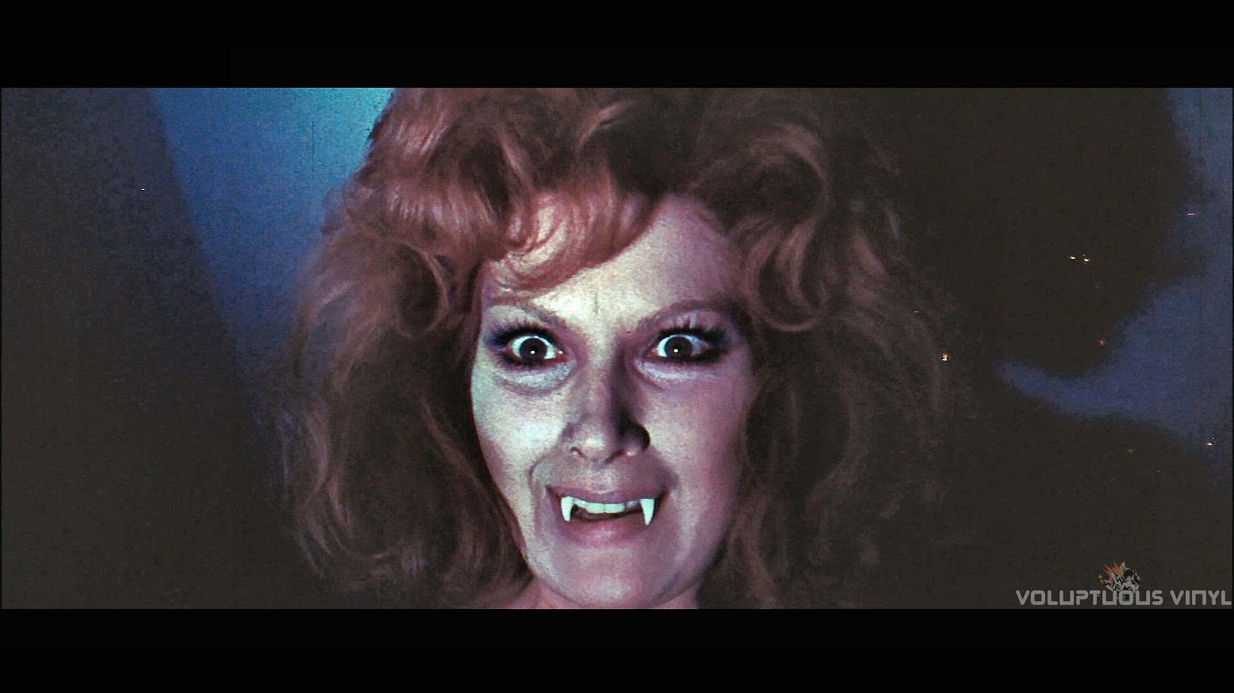 Helga Line smiles a toothy fanged grin in The Vampires Night Orgy