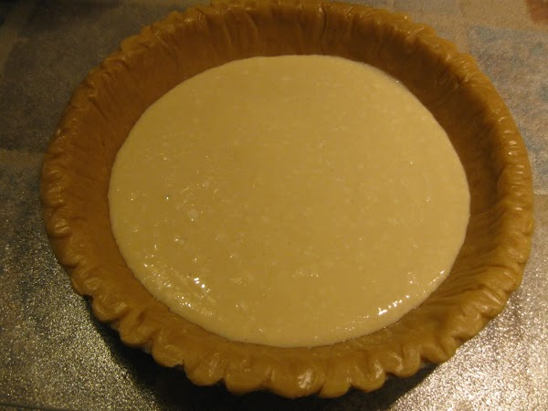 Mix together the softened neufchatel cheese, sugar, egg, and vanilla until creamy.  Pour...