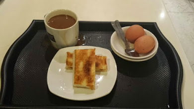 Photo: Kaya Toast - traditional Singaporean breakfast. Delicious but not so fond of the raw eggs