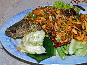 "Photo: fried snakehead fish topped with spicy salad (""pla boran"")"