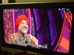 """Photo: Chadha (Mr. Sarbjit Singh Chadha) is Japan's first Indian Enka singer. According to Wikipedia (Japanese: http://ja.wikipedia.org/wiki/%E3%83%81%E3%83%A3%E3%83%80), he came to Japan when he was 16 with his brothers to learn orange farming. Then he fell in love with Enka, a genre in Japanese pop music (http://en.wikipedia.org/wiki/Enka), and pursued to be a singer under great masters like Saburo Kitajima (http://en.wikipedia.org/wiki/Sabur%C5%8D_Kitajima). His debut was 1975, but due to several restrictions, he changed his courses and founded a successful import / export business that grew to 1 billion JPY (around 10 million USD) annual turnover. Yes, he is Sardarji! In 2008, he transferred his business to his Japanese wife in India and return to the Enka world. Photo captures him singing """"Omokage no Hito"""" in an NHK program this June. 14th August updated - http://jp.asksiddhi.in/daily_detail.php?id=270"""