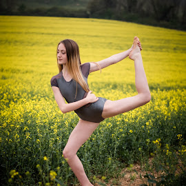 Tiptoeing the field of gold by Vix Paine - Babies & Children Child Portraits ( beauty, dancers, pose, rapeseed field, dance photography, child dancer, dance move, yellow, ballet, sisters, bare feet, teenagers, flower, dancer, working together, colour, rapeseed, family, sister, child, teenager )