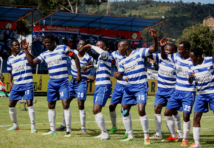 Allan Wanga (2nd L ) perform a dance with his former AFC Leopards team-mates