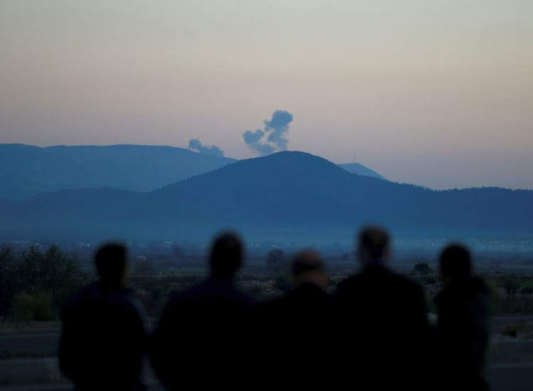 Smoke rises from the Syria's Afrin region, as it is pictured from near the Turkish town of Hassa, on the Turkish-Syrian border in Hatay province, Turkey January 20, 2018.