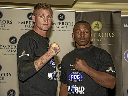 "Thomas ""Tommy Gun"" Oosthuizen faces off with Thabiso ""The Rock"" Mchunu. The boxers are scheduled to exchange leather in Golden Gloves' tournament on September 1."