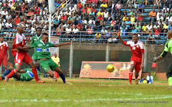 Photo: The Seychelles pull down Sheriff Suma, conceding a penalty [Leone Stars v Seychelles, Freetown, 19 July 2014 (Pic: Darren McKinstry)]