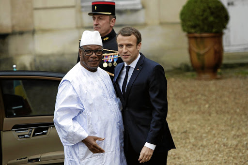 CAPTION: Mali's President Ibrahim Boubacar Keita is greeted by French President Emmanuel Macron ahead of a counter-terrorism meeting of leaders of the G5 Sahel countries, European countries and Saudi Arabia, in La Celle-Saint-Cloud, near Paris, on December 13 2017. Picture: REUTERS