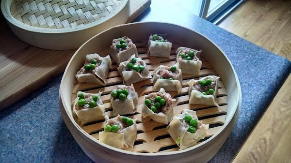 Place the dim sums in bamboo steamer and steam over boiling water for about...