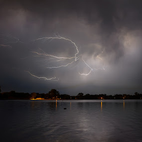 Lightning is reflected in Lake Marion in Lakeville, MN early in the morning on September 5th, 2012. by Devyn Drufke - Landscapes Weather