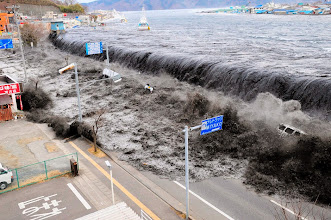 Photo: A wave approaches Miyako City from the Heigawa estuary in Iwate Prefecture after the magnitude 8.9 earthquake struck the area March 11, 2011.  Picture taken March 11, 2011.  REUTERS/Mainichi Shimbun(JAPAN - Tags: DISASTER ENVIRONMENT IMAGES OF THE DAY) FOR EDITORIAL USE ONLY. NOT FOR SALE FOR MARKETING OR ADVERTISING CAMPAIGNS. JAPAN OUT. NO COMMERCIAL OR EDITORIAL SALES IN JAPAN