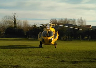 Photo: The pilot busy around the machine as the co-pilot attended the first aid scene.