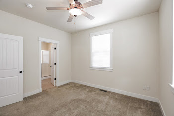 A1 bedroom with carpet and ceiling fan