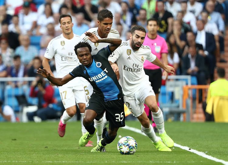 Club Brugge's Percy Tau in action with Real Madrid's Dani Carvajal and Raphael Varane during a Uefa Champions League match on October 1 2019.